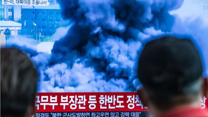 Passengers at Seoul station watch news report showing North Korea blowing up the liaison office it shared with South Korea on June 16.