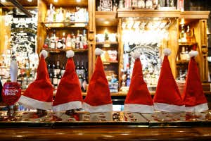 Christmas hats cover beer taps inside a pub in London, UK, on Monday 14 December