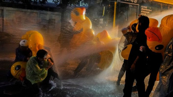Democracy protesters used inflatable rubber ducks to shield themselves from water cannons in Bangkok on November 17, 2020