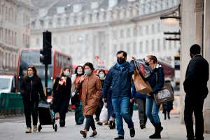 Shoppers in London's main high-street shopping district on Regent street
