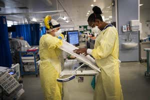 Two nurses wearing personal protective equipment in the Intensive Care Unit in St George's Hospital in Tooting, south-west London on 7 January