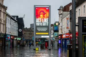 'Stay Home Save Lives' publicity campaign poster in Newcastle upon Tyne, England