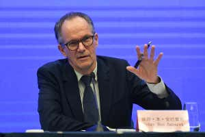Peter Ben Embarek, a member of the WHO-China joint study team, gestures with his hand as he answers a question during a press conference