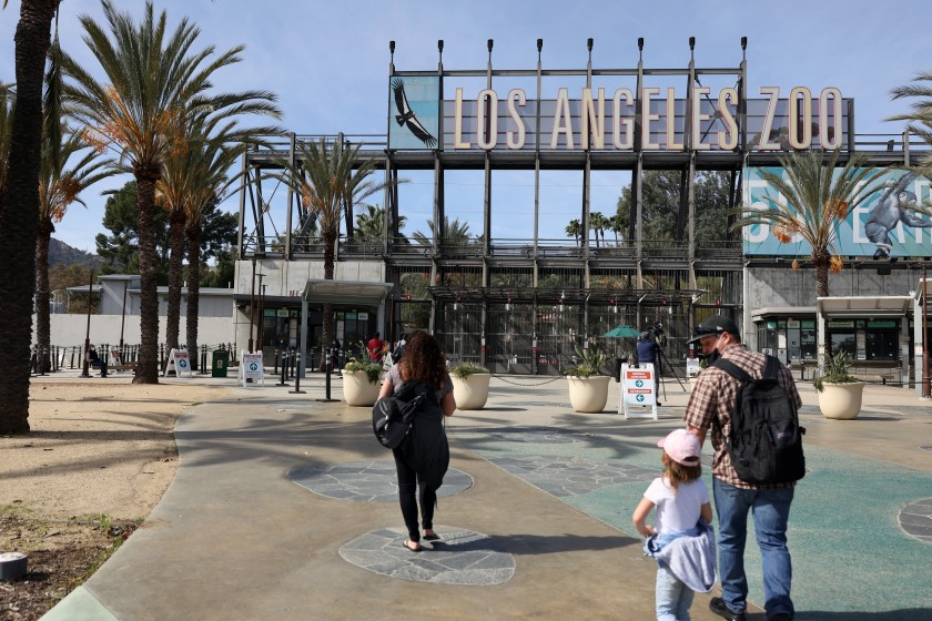People enter the Los Angeles Zoo