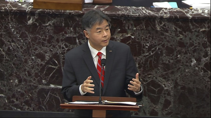 Ted Lieu speaks at a podium.