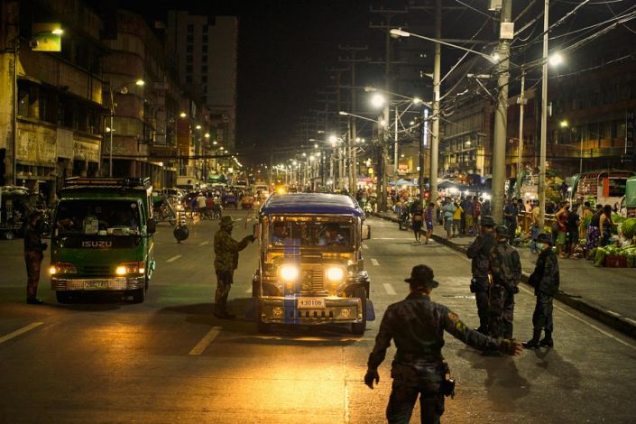 """Police check vehicles in Manila during the coronavirus pandemic on March 18, 2020.<span class=""""copyright"""">Jes Aznar—The New York Times/Redux</span>"""