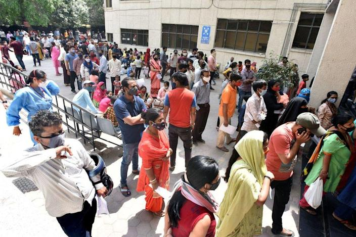People line up to get tested for Covid-19 during a special testing camp at Chacha Nehru hospital in Geeta colony, on April 16, 2021 in New Delhi, India.
