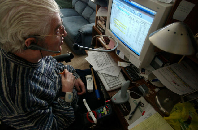 In this 2006 photo, Rollie Berg—who has extremely limited use of his hands due to multiple sclerosis—uses Dragon NaturallySpeaking 8 to interact directly with his PC.
