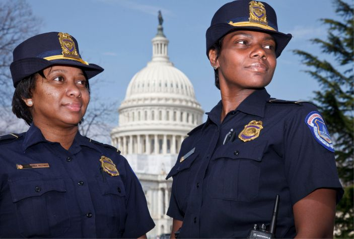 Acting Capitol Police Chief Yogananda Pittman, left, and Monique Moore were the first two African American women to achieve the rank of captain on the force.