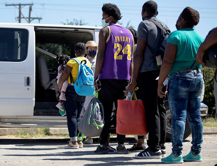 Haitian migrants who are seeking asylum wait to get into a van to be transported from Del Rio, Texas, the United States, Sept. 24, 2021. (Nick Wagner/Xinhua via Getty Images)